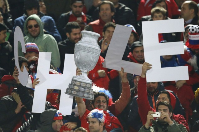 Chilean fans celebrate during the opening match of the Copa America 2015 soccer tournament against Ecuador in the National Stadium in Santiago