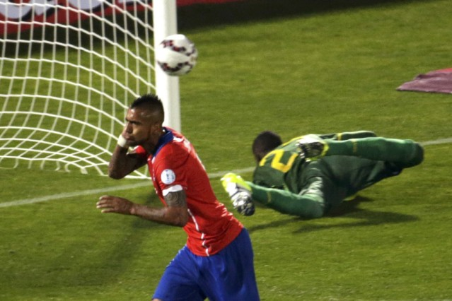 Chile's Vidal celebrates after scoring on a penalty kick against Ecuador during the opening match of the Copa America 2015 soccer tournament in the National Stadium in Santiago