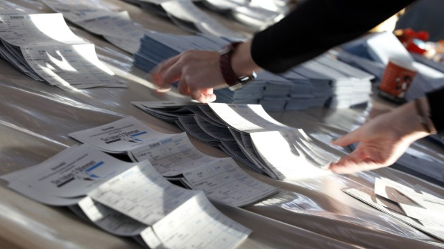 Electoral official sorts ballot papers in Munich