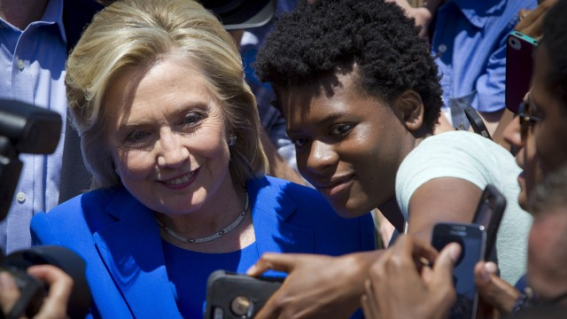 U.S. Democratic presidential candidate Hillary Clinton poses for a photo following her 'official launch speech' at a campaign kick off rally in Franklin D. Roosevelt Four Freedoms Park on Roosevelt Island in New York City