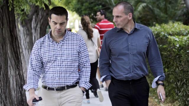 Greek Tsipras, Varoufakis walk in a park of Athens