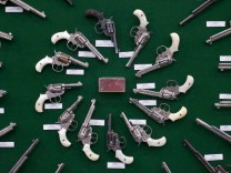 Factory engraved Colt revolvers are displayed at venue for NRA meeting, in Houston, Texas