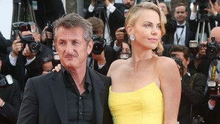 Sean Penn and Charlize Theron arrive on the red carpet before the screening of the film Mad Max Fu