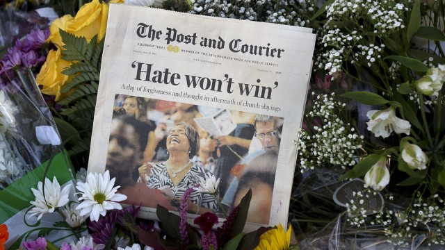 A newspaper left as a sign of support is pictured at a makeshift memorial at Emanuel African Methodist Episcopal Church in Charleston