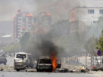 Vehicle is seen on fire after a blast near the Afghan parliament in Kabul, Afghanistan