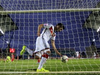 Germany's Ilkay Gundogan picks up the ball after scoring a goal against Gibraltar during their Euro 2016 qualifying soccer match at Algarve stadium in Faro, Portugal