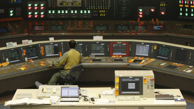 An employee works in the central control room of the No.5 reactor at Chubu Electric Power Co.'s Hamaoka Nuclear Power Station in Omaezaki