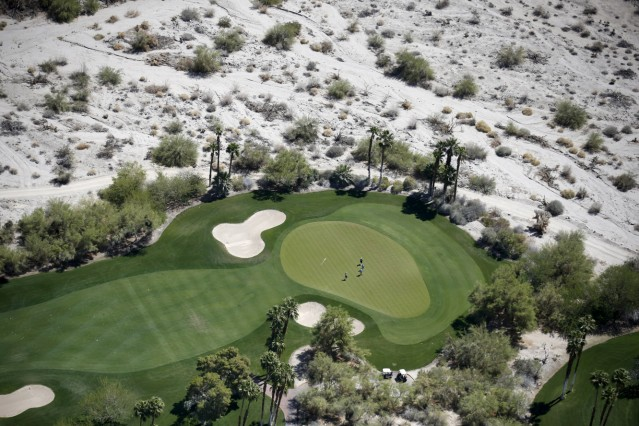 People play golf on a course in La Quinta
