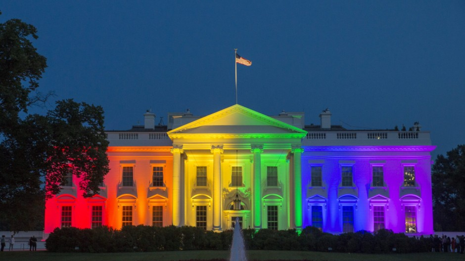 The White House is illuminated with rainbow colors