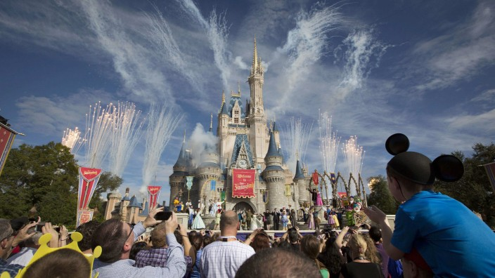 File of fireworks going off around Cinderella's castle during the grand opening ceremony for Walt Disney World's new Fantasyland in Lake Buena Vista, Florida