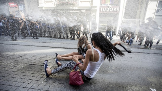 Riot police use a water cannon to disperse LGBT rights activist before a Gay Pride Parade in central Istanbul, Turkey
