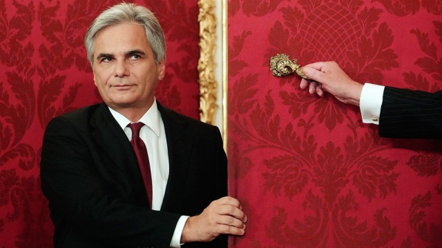 Austrian Chancellor Faymann arrives for the inauguration of new government members at the presidential office in Vienna