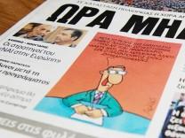 Titelseite einer griechischen Zeitung mit einer Karikatur von Arkas