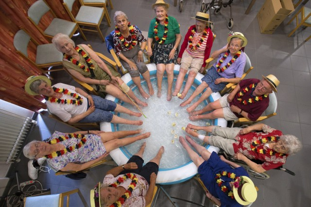 Residents at the Ter Biest house for elderly persons refresh their feet in a swimming pool on a hot summer day in Grimbergen