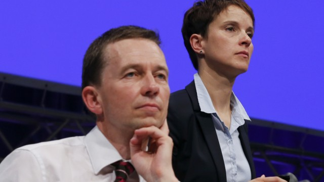 Lucke founder and co-chairman of AfD sits next to AfD co-chairman Petry during party congress in Essen