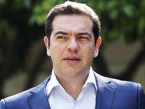 Greek Prime Minister Tsipras leaves Maximos Mansion for a meeting with party leaders at the Presidential Palace in central Athens