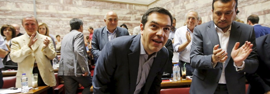 Greek Prime Minister Tsipras arrives for a session of ruling Syriza's leftist party parliamentary group at the Parliament building in Athens