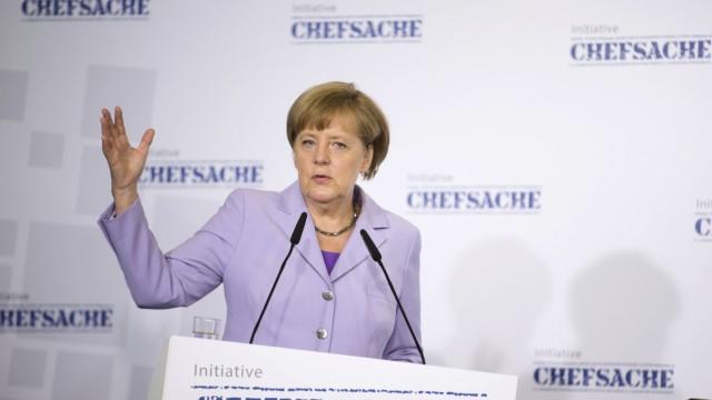 German Chancellor Merkel speaks during a meeting on the role of women in leadership in Berlin