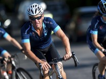 Cyclist Lance Armstrong of the US cycles with a team of riders as he takes part in Geoff Thomas's 'One Day Ahead' charity event during a stage of the 102nd Tour de France cycling race from Muret to Rodez