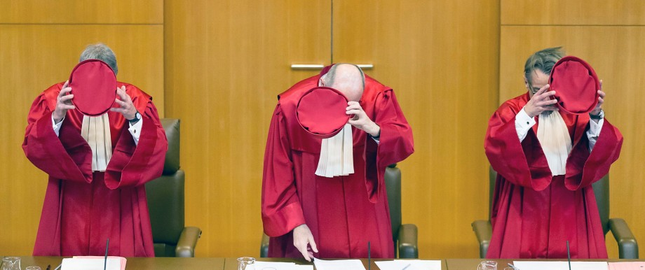 Judges Eichberger, vice-president of Germany's Constitutional Court Kirchhof and Gaier take off their hats after the announcement of the verdict on an inheritance law file at Germany's Federal Constitutional Court (Bundesverfassungsgericht) in Karlsruhe