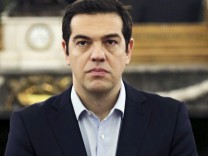 Greek PM Tsipras looks on during a swearing in ceremony of members of his government at the Presidential Palace in Athens