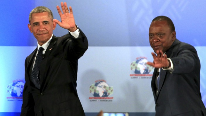 U.S. President Barack Obama and Kenya's President Uhuru Kenyatta gesture onstage after delivering remarks at the Global Entrepreneurship Summit at the United Nations compound in Nairobi, Kenya
