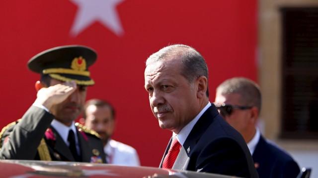 Turkey's President Tayyip Erdogan looks on durin his visit to Northern Cyprus