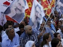 Demonstrators holding flags with the imprisonde Kurdish rebel leader Abdullah Ocalan, gather at Galatasaray square during a protests against the bomb attack in the border town of Suruc, in central Istanbul, Turkey