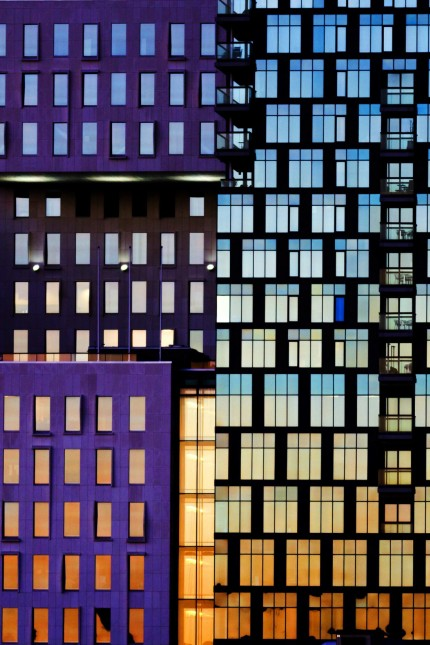 The sunset is reflected off the buildings of The Barcode Project in Oslo