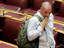 Former Greek Finance Minister Yanis Varoufakis reacts during a parliamentary session in Athens