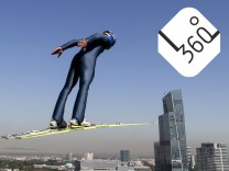 A skier soars through the air during training session at the Sunkar Ski Jumping complex in Almaty