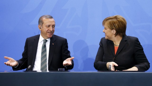 German Chancellor Merkel and Turkey's Prime Minister Erdogan address the media after talks in Berlin