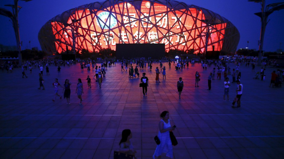 A message of congratulation is projected onto the Bird's Nest Olympic stadium as people gather after Beijing was chosen to host the 2022 Winter Olympics in Beijing