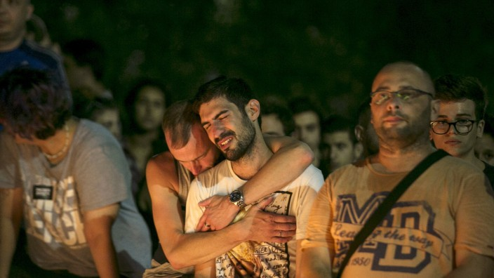People react during candlelight vigil in Tel Aviv
