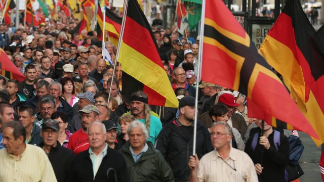 Refugees Arrive In Dresden Amidst Protests