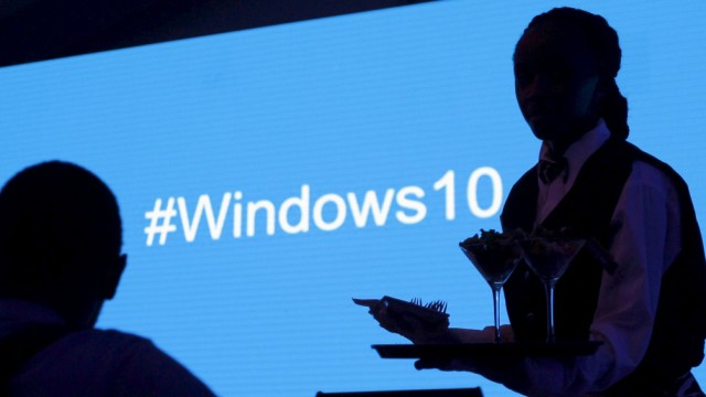 A waitress serves a Microsoft delegate during the launch of the Windows 10 operating system in Kenya's capital Nairobi
