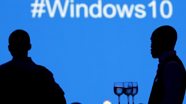A waiter serves a Microsoft delegate during the launch of the Windows 10 operating system in Kenya's capital Nairobi