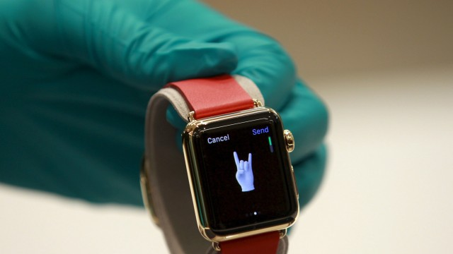 File photo of a sales assistant showing an Apple Watch Edition at an Apple reseller shop in Bangkok