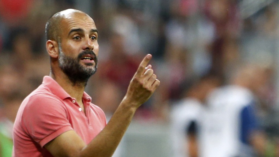Bayern Munich's coach Guardiola reacts during their pre-season Audi Cup tournament final soccer match against Real Madrid in Munich