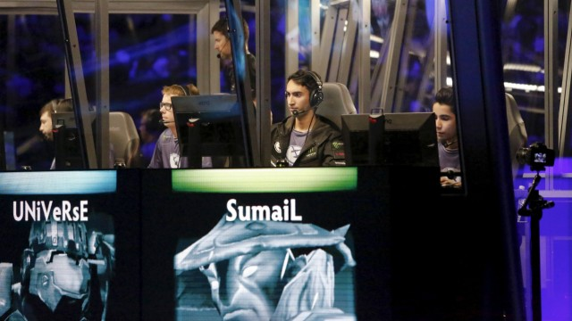 Members of Evil Geniuses compete in the Grand Finals of The International Dota 2 Championships at Key Arena in Seattle, Washington