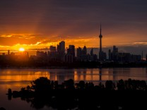 The sun rises over the skyline in Toronto