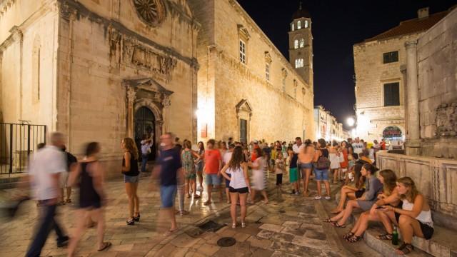 Dubrovnik at night 27 07 2015 Dubrovnik Croatia Stradun at town is full of tourists during nigh