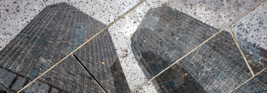 The headquarters of the Deutsche Bank are reflected in the polished floor, in Frankfurt
