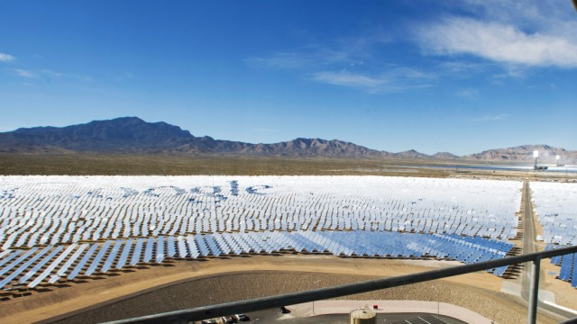 Katie Kukulka, an information officer with the California Energy Commission, takes photos during a tour of the Ivanpah Solar Electric Generating System in the Mojave Desert near the California-Nevada border