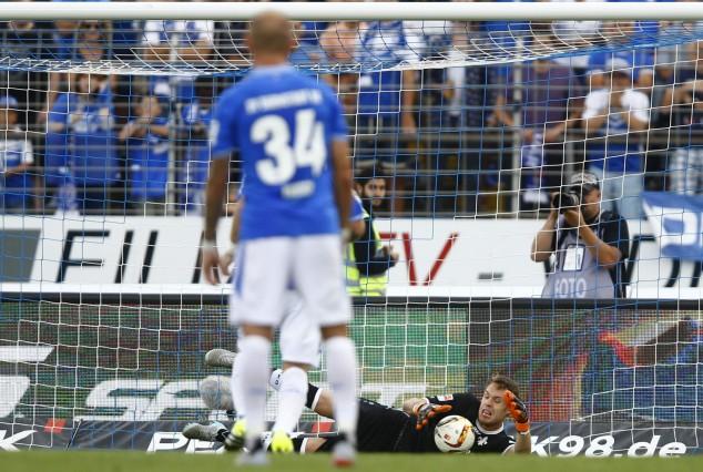 SV Darmstadt 98's goalkeeper Mathenia saves a penalty shot of Hanover 96's Erdinc during their German first division Bundesliga soccer match in Darmstadt