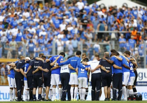 SV Darmstadt 98 players get together after their German first division Bundesliga soccer match against Hanover 96 in Darmstadt