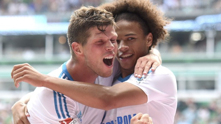 Schalke 04's Huntelaar celebrates his goal with teammate Sane during their German first division Bundesliga soccer match against Werder Bremen in Bremen
