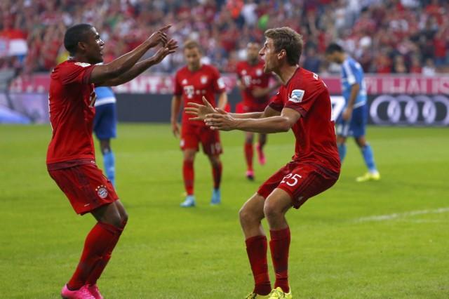 Bayern Munich's Mueller celebrates with Costa after scoring a goal past Hamburger SV's Adler in Bundesliga soccer match in Munich