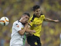 Borussia Dortmund's Weigl jumps for a header with Borussia Moenchengladbach's Xhaka Bundesliga first division soccer match in Gelsenkirchen