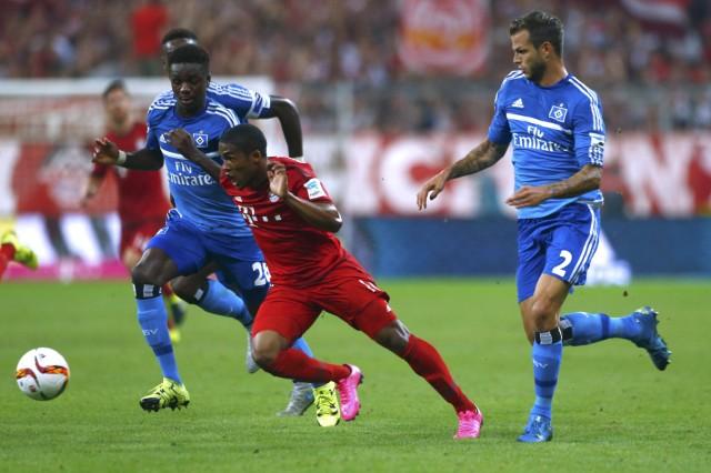 Bayern Munich's Costa is challenged by Hamburger SV's Jung and Diekmeier in Bundesliga soccer match in Munich